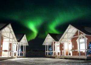 Northern lights over the Santa Claus Holiday Village in Rovaniemi