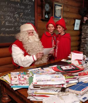Santa Claus and Elves in Santa Claus Main Post Office in Rovaniemi in Lapland