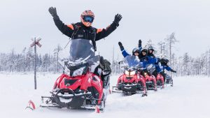 Snowmobiling at the Arctic Circle in Rovaniemi in Lapland